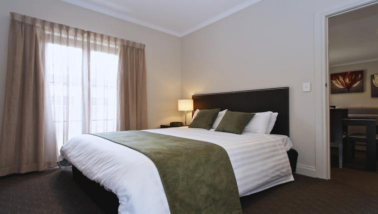 Bed at Mantra on Frome - Citybase Apartments