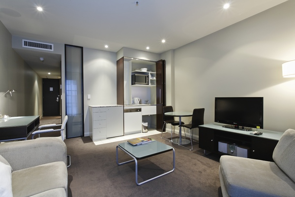 Fresh living area in Mantra Hindmarsh Square - Citybase Apartments