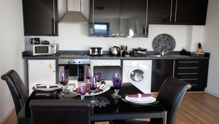 Dining area at Westport Luxury Serviced Apartments - Citybase Apartments