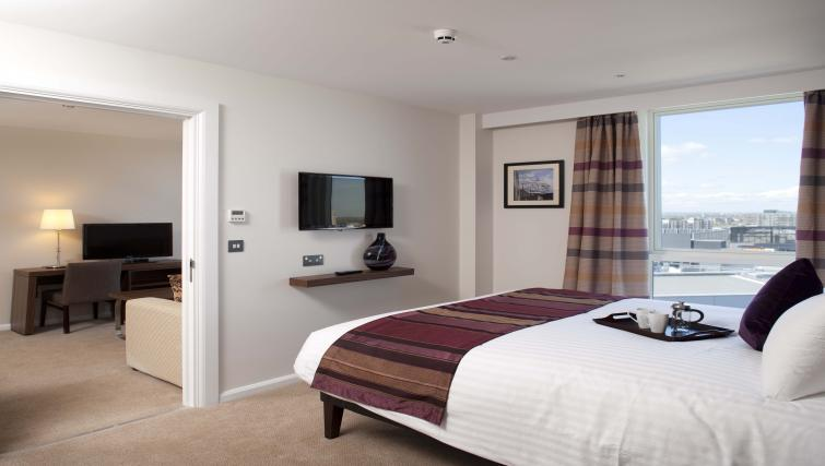 Stylish bedroom in Staybridge Suites London Stratford City - Citybase Apartments