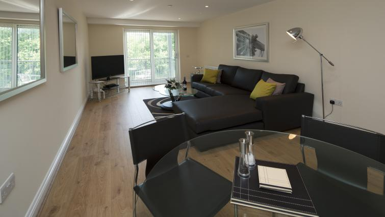 Living room at Equinox Place - Citybase Apartments