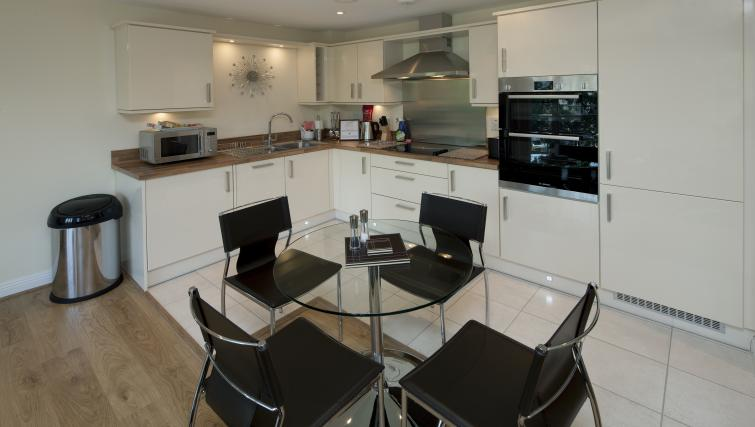 Kitchen/dining area at Equinox Place - Citybase Apartments