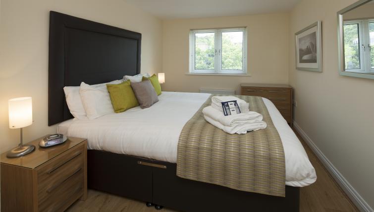 Bed at Equinox Place - Citybase Apartments