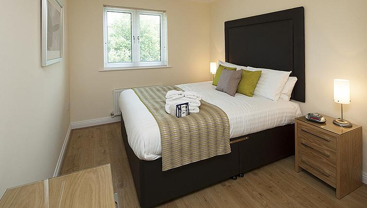 Sophisticated bedroom in Equinox Place - Citybase Apartments