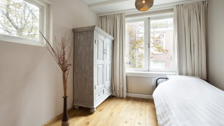 Elegant bedroom at Stephan Apartments, Amsterdam - Citybase Apartments