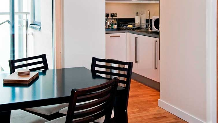 Dining table and chairs in Byron House Apartments - Citybase Apartments