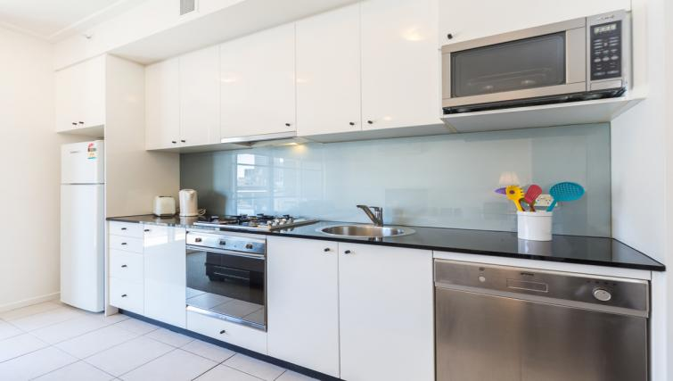 Equipped kitchen at Astra Apartments Sydney CBD Rex - Citybase Apartments