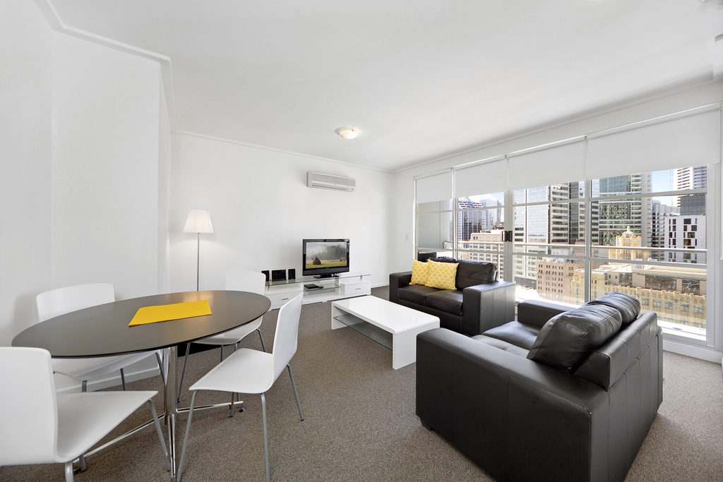 Living diner at Astra Apartments Sydney CBD Rex - Citybase Apartments