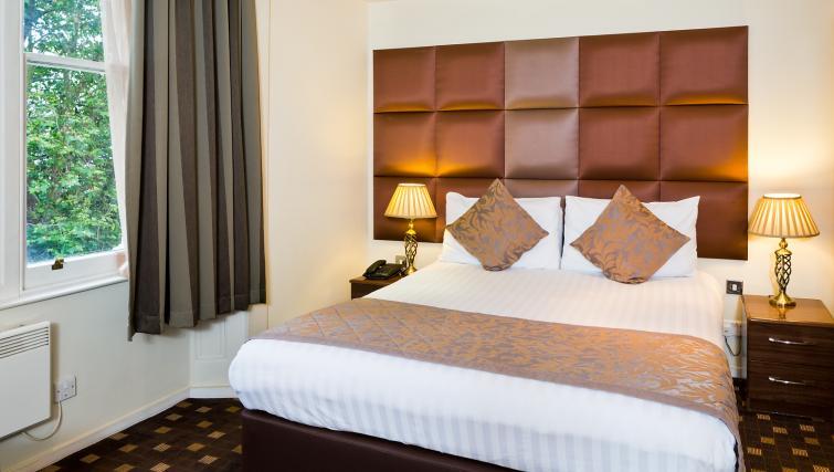 Bedroom at Grand Plaza Apartments - Citybase Apartments