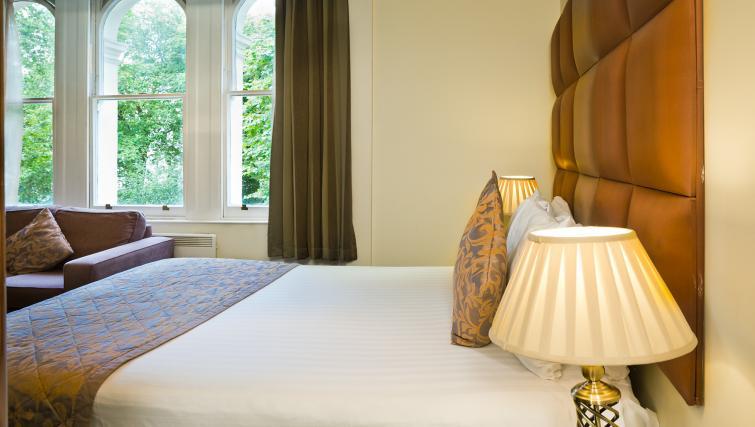 Bed at Grand Plaza Apartments - Citybase Apartments