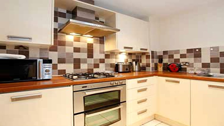Practical kitchen in Mandara Point Apartments - Citybase Apartments