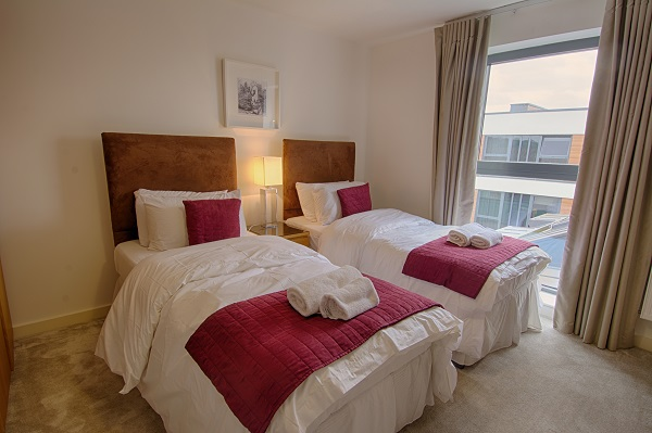Twin beds at The Residence Apartments - Citybase Apartments