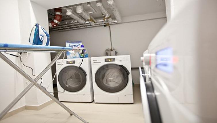 Practical communal laundry room in Goodmans Living Apartments - Citybase Apartments