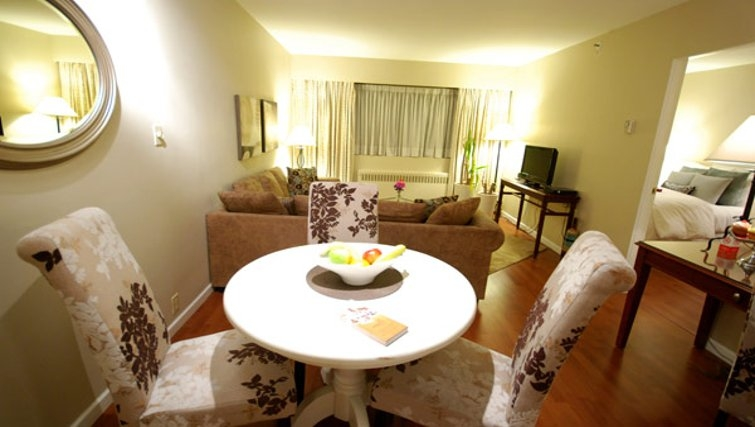 Elegant dining area in Rosellen Suites at Stanley Park - Citybase Apartments