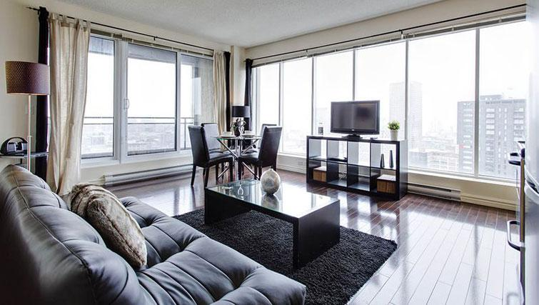 Living/dining area at Le 400 Sherbrooke Ouest Apartments - Citybase Apartments