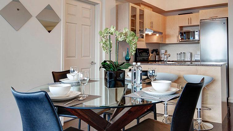 Classy dining area in Le 400 Sherbrooke Ouest Apartments - Citybase Apartments