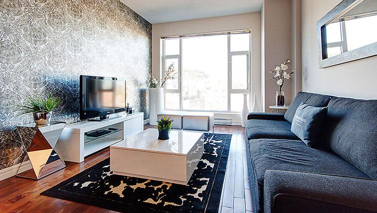 Modern living area in Le 400 Sherbrooke Ouest Apartments - Citybase Apartments