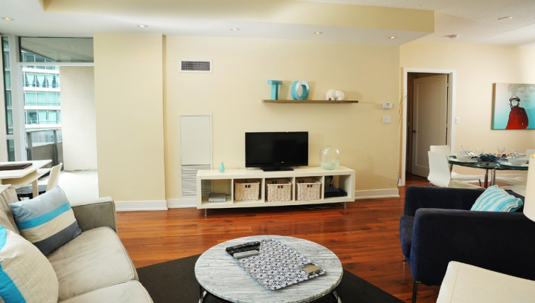 Charming living area in 20 Blue Jays Way - Citybase Apartments