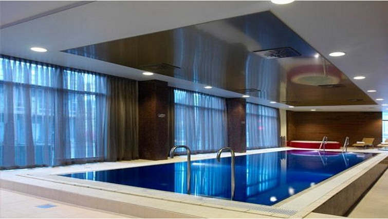 Large indoor swimming pool at Adina Apartment Hotel Copenhagen - Citybase Apartments