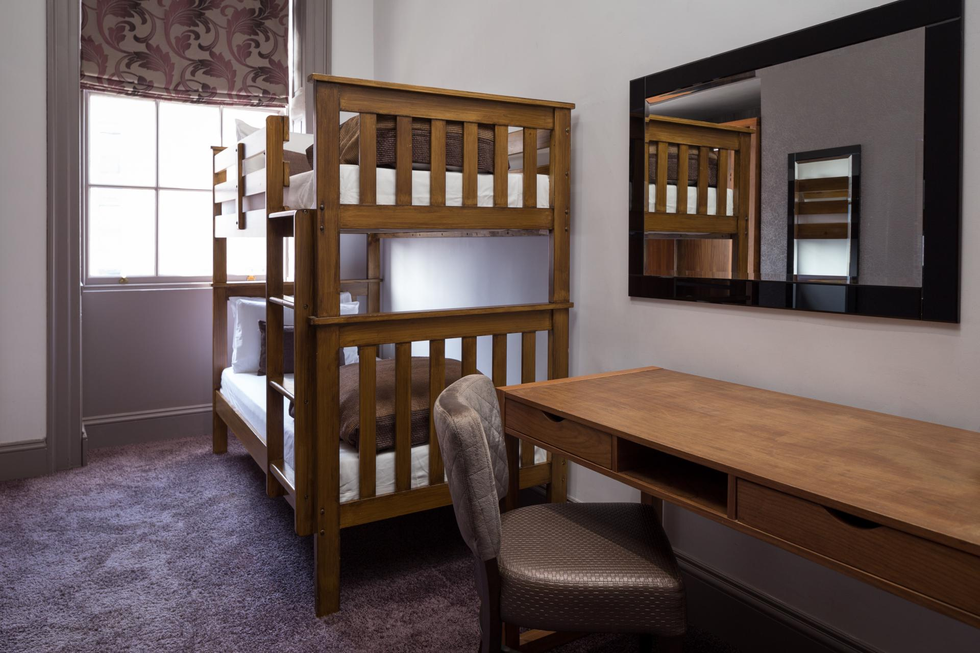 Bunk bed at Roomzzz Newcastle City Apartments - Citybase Apartments