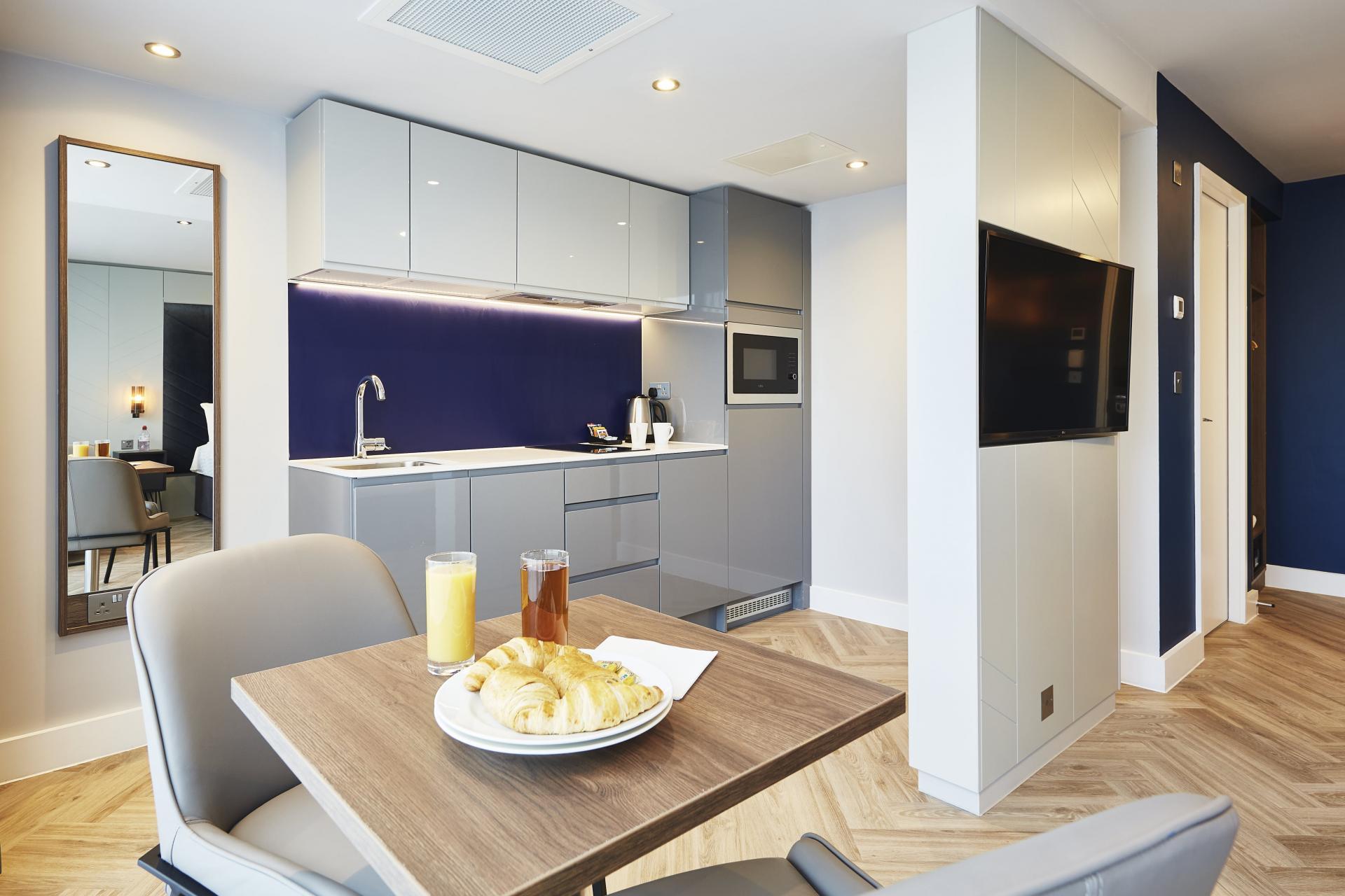 Kitchen at Roomzzz Newcastle City Apartments - Citybase Apartments