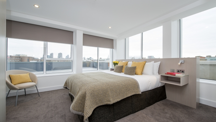 Bright bedroom in The Rosebery Aparthotel - Citybase Apartments