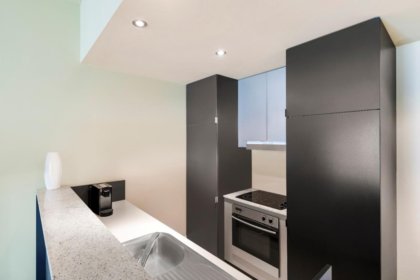 Kitchen at Adina Apartment Hotel Adelaide Treasury, Centre, Adelaide - Citybase Apartments