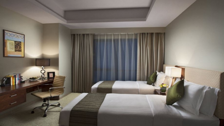 Practical bedroom in Hyatt Residence Doha West Bay - Citybase Apartments