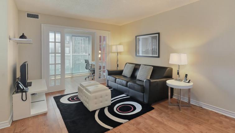 Sofa at Qwest Apartments - Citybase Apartments