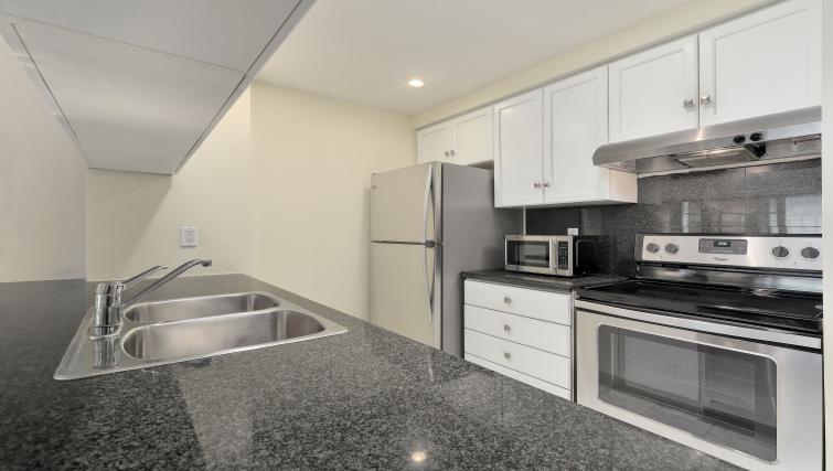 Kitchen at Qwest Apartments - Citybase Apartments