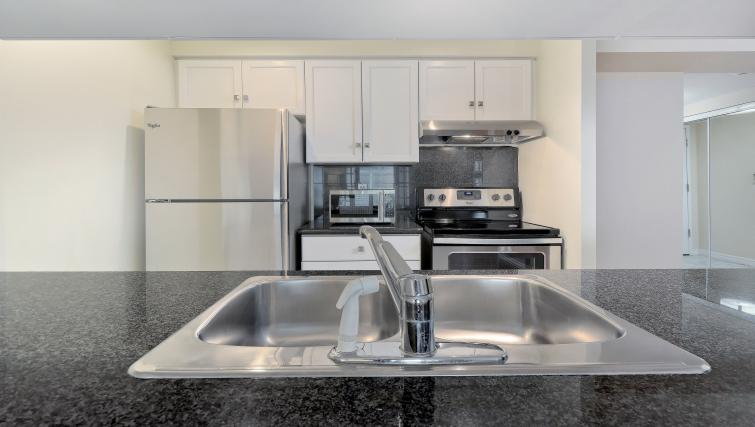 Sink at Qwest Apartments - Citybase Apartments