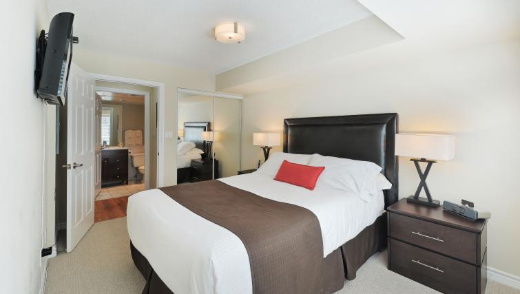 Bedroom at Qwest Apartments - Citybase Apartments