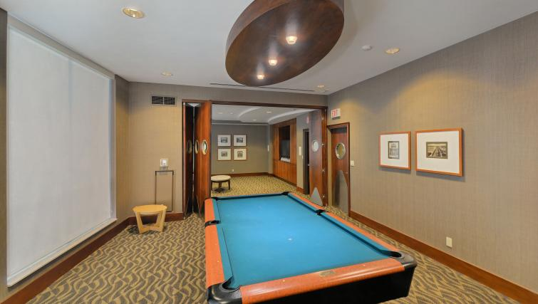 Billiards room at Qwest Apartments - Citybase Apartments