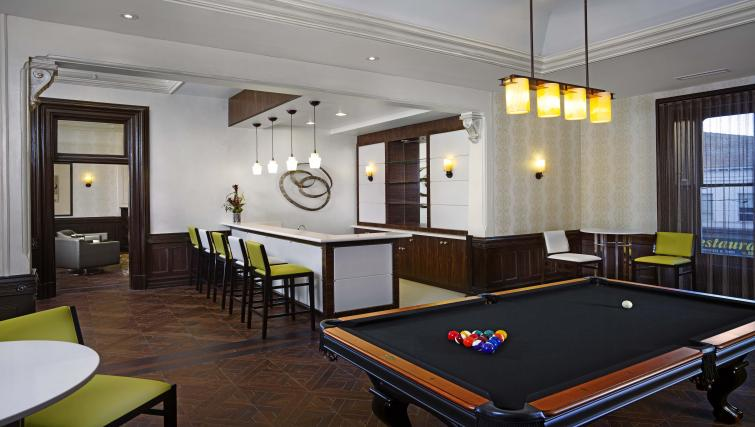 Billiards room in James Cooper Mansion Apartments - Citybase Apartments