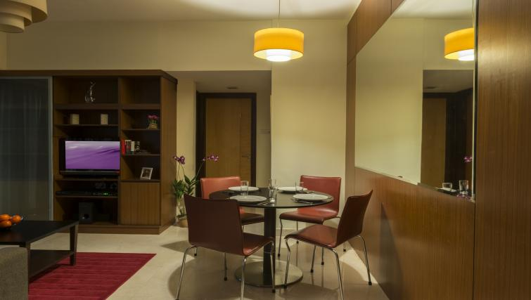 Dining table and chairs at Somerset Bencoolen Apartments, Singapore - Citybase Apartments