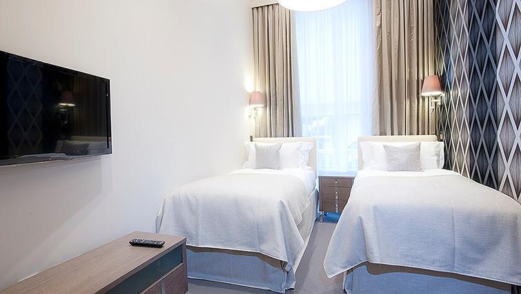 Bright bedroom at Ashburn Court Apartments - Citybase Apartments