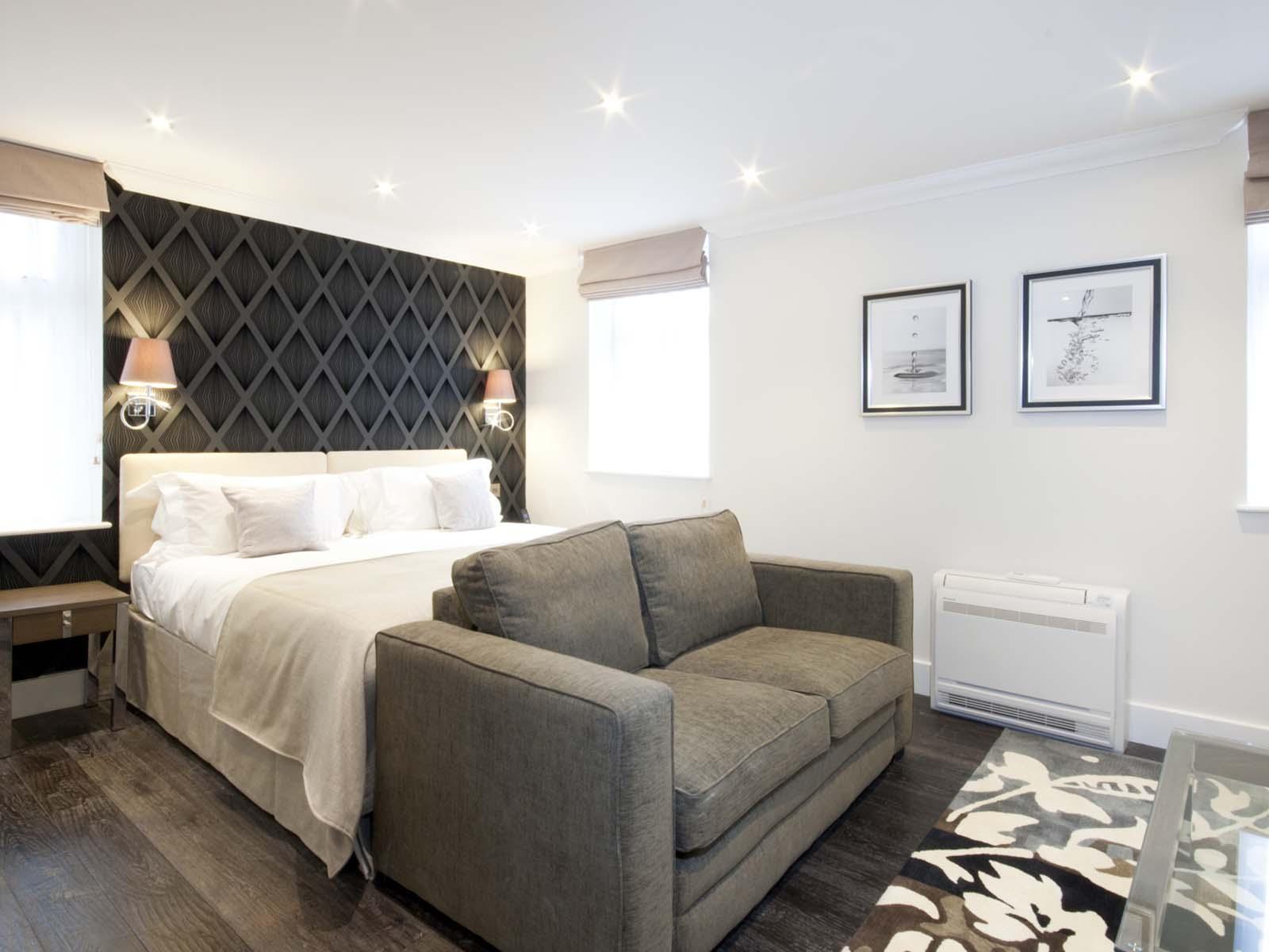 Comfortable bed at Ashburn Court Apartments - Citybase Apartments