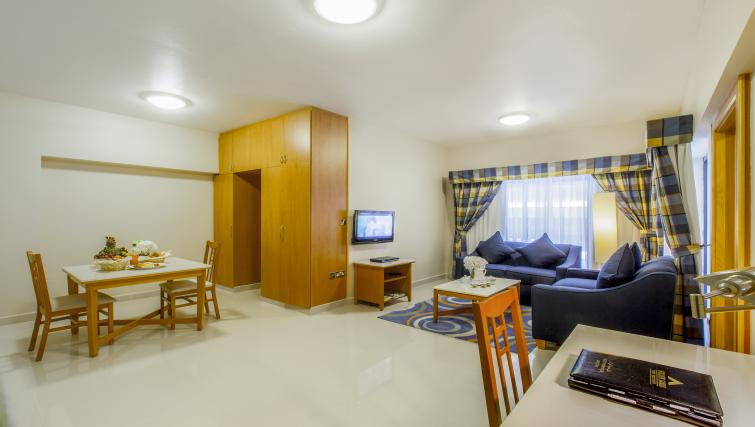 Living space and dining area at Golden Sands Apartments - Citybase Apartments