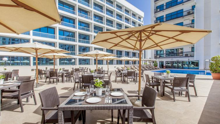 Poolside terrace at Golden Sands Apartments - Citybase Apartments