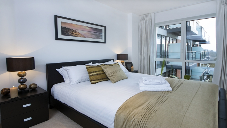 Comfortable bedroom in Dickens Yard Apartments - Citybase Apartments