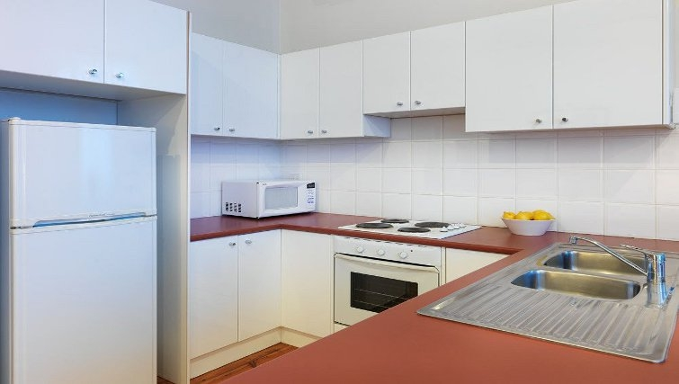 Bright kitchen in Adina Apartment Hotel Melbourne, Flinders Street - Citybase Apartments