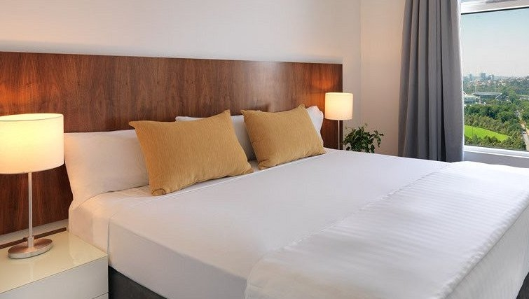 Warm bedroom of Adina Apartment Hotel Melbourne, Flinders Street - Citybase Apartments