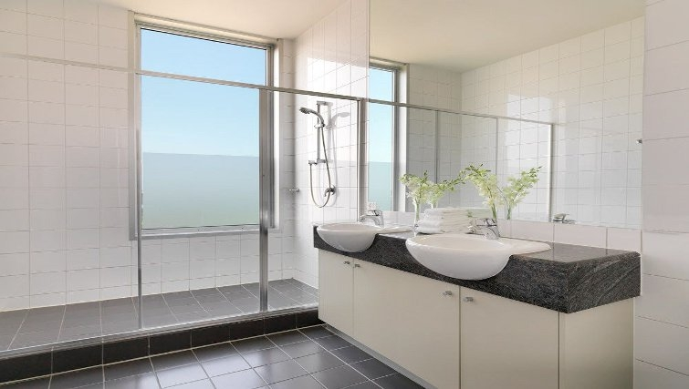 Elegant bathroom in Adina Apartment Hotel Melbourne, Flinders Street - Citybase Apartments