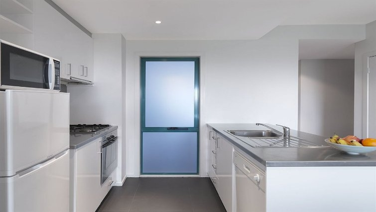 Bright kitchen in Adina Apartment Hotel Melbourne, St Kilda - Citybase Apartments
