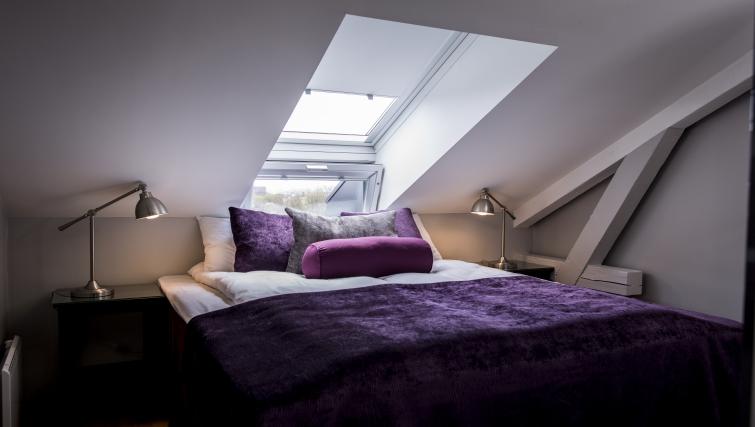 Comfortable bedroom in Underhaugsveien Apartments. - Citybase Apartments