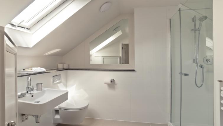 Sleek bathroom at Cambridge Place Apartments - Citybase Apartments