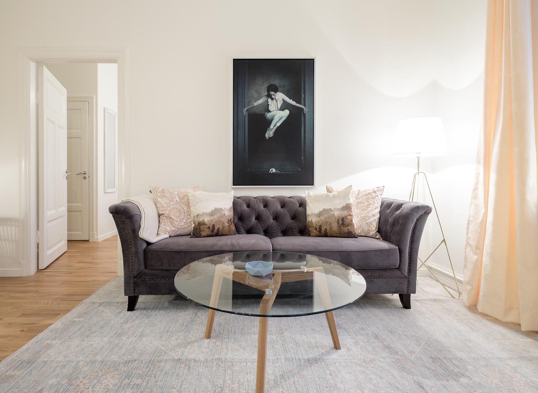 Sofa at Upplandsgatan Apartments - Citybase Apartments