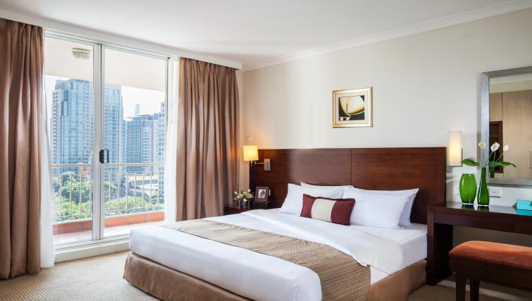 Comfortable bedroom at Somerset Chancellor Court Apartments - Citybase Apartments
