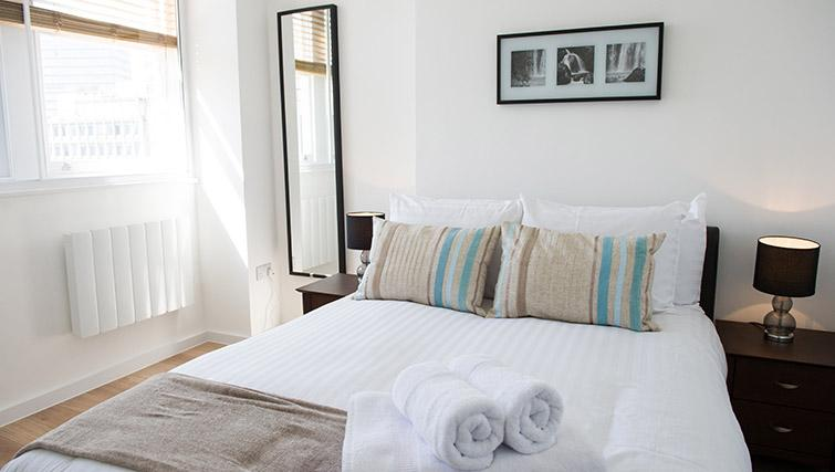 Bed at West End by Q Apartments - Citybase Apartments