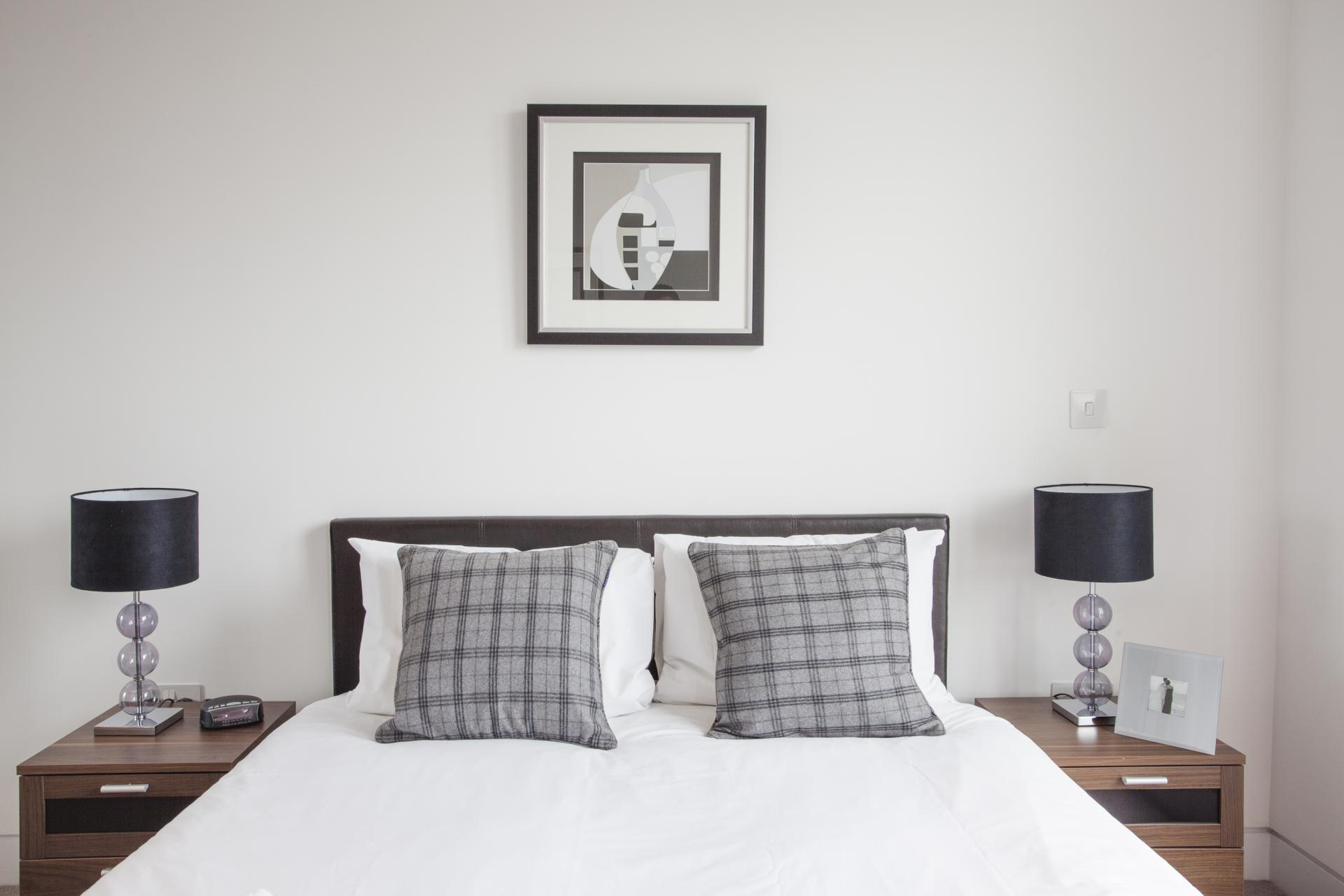 Comfortable bedroom at London Square Apartments - Citybase Apartments